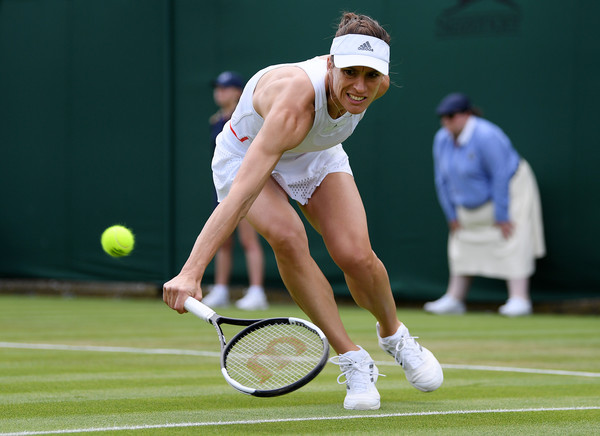 Day Two: The Championships - Wimbledon 2019 [ladies singles,sports,tennis,tennis racket,tennis court,tennis player,sport venue,racket,sports equipment,championship,competition event,andrea petkovic,monica niculescu,backhand,germany,romania,england,london,wimbledon,match]