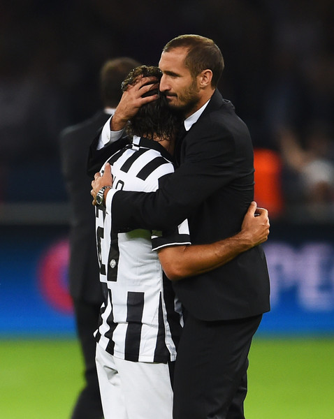Juventus v FC Barcelona  - UEFA Champions League Final [championship,player,interaction,team sport,sports,competition event,tournament,ball game,sports equipment,gesture,andrea pirlo,giorgio chiellini,olympiastadion,berlin,germany,juventus,fc barcelona,uefa champions league,l,final]