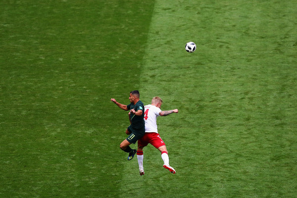 Denmark vs. Australia: Group C - 2018 FIFA World Cup Russia [player,sport venue,football player,green,team sport,football,grass,soccer player,sports,soccer,andrew nabbout,simon kjaer,denmark,russia,australia,samara arena,australia: group c - 2018 fifa world cup,header ball,battle,2018 fifa world cup]