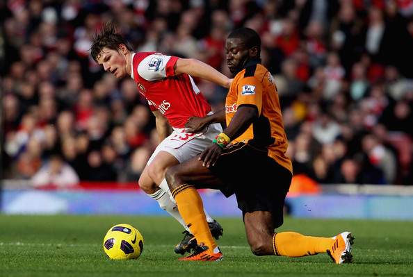 Andrey Arshavin Andrey Arshavin of Arsenal in action with George Elokobi of Wolves (L) during the Barclays Premier League match between Arsenal and Wolverhampton Wanderers on February 12, 2011 in London, England.