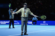 Actors from the Sitcom 'Still Game' come onto the court during the doubles match between Andy Murray, Jamie Murray, Mansour Bahrami and Tim Henman during Andy Murray Live at The Hydro on November 7, 2017 in Glasgow, Scotland.