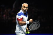 "Iran's Mansour Bahrami gestures during his exhibition doubles match with Britain's Tim Henman against Britain's Andy Murray and Britain's Jamie Murray at ""Andy Murray Live"" at the SSE Hydro in Glasgow, Scotland on November 7, 2017. .""Andy Murray Live"" is a charity fundraiser. Glasgow based charity, Sunny-sid3up, join Unicef as charity partner this year. / AFP PHOTO / Andy BUCHANAN"