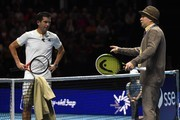 "Britain's Tim Henman (L) speaks with an actor from the BBC Scotland sitcom ""Still Game"" during Henman and Iran's Mansour Bahrami's doubles game against The Murray brothers at ""Andy Murray Live"" at the SSE Hydro in Glasgow, Scotland on November 7, 2017. .""Andy Murray Live"" is a charity fundraiser. Glasgow based charity, Sunny-sid3up, join Unicef as charity partner this year. / AFP PHOTO / Andy BUCHANAN"