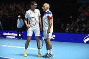 "Iran's Mansour Bahrami speaks with Britain's Tim Henman (L) during their exhibition doubles match against Britain's Andy Murray and Britain's Jamie Murray at ""Andy Murray Live"" at the SSE Hydro in Glasgow, Scotland on November 7, 2017. .""Andy Murray Live"" is a charity fundraiser. Glasgow based charity, Sunny-sid3up, join Unicef as charity partner this year. / AFP PHOTO / Andy BUCHANAN"
