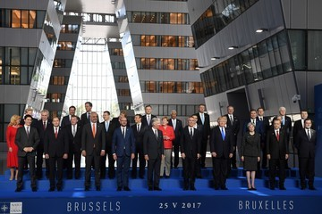 Angela Merkel Jens Stoltenberg Trump Visits Brussels for His First Talks With NATO and European Union leaders