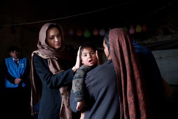 Angelina Jolie In this handout provided by the UNHCR, UNHCR Goodwill Ambassador, Angelina Jolie, meets with Khanum Gul, 35, a mother of 8 and her youngest son, Samir at their makeshift home at Tamil Mill Bus site February 2011, in Kabul city, Afghanistan. When Angelina last visited Khanum Gul, Samir was a newly born baby of 14 days, now he's two and a half years old, but having medical problems. Tajik and Pashtun families live side by side without any major conflict at the Tamil Mill Bus site. Over 70 percent of the families are returnees from the period of 2002-2004 who were unable to achieve sustainable reintegration in their places of origin and subsequently drifted to Kabul City in search of work. A nearby school is accessible to the children but the poor economic circumstances of the many families oblige them to send their children out to work. Low levels of literacy, particularly amongst the women, limit their access to employment other than the lowest paid daily labour wage.
