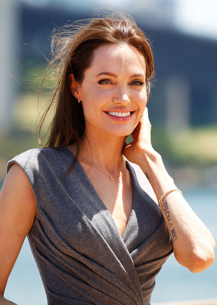 Angelina Jolie Angelina Jolie poses at the photo call of Unbroken at Sydney Opera House on November 18, 2014 in Sydney, Australia.