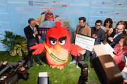 """(L-R) Mr. Ban Ki-Moon, 'Red', Jason Sudeikis, Josh Gad, Maya Rudolph, John Cohen and Cristina Gallach attend the United Nations Ceremony, Presentation and Photo Call naming Red, from the """"ANGRY BIRDS"""" movie, Honorary Ambassador for the International Day of Happiness, to be observed around the world on March 20th, at United Nations on March 18, 2016 in New York City."""