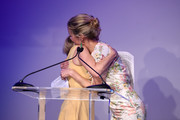 Animal Haven Director Tiffany Lacey .and Carolyn Murphy embrace onstage during the Animal Haven Gala 2019 at Tribeca 360 on May 22, 2019 in New York City.
