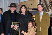 Actor Danny Huston (L), Stella Houston (2nd-R) and directror Wes Anderson (R) attend a ceremony honoring actress Anjelica Huston (C) with the 2398th star on the Hollywood Walk of Fame on January 22, 2010 in Hollywood, California.