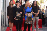 Ann Wilson (front L), Nancy Wilson (front R) with Rita Wilson (back L) Sean Kinney, Mike Inez and William DuVall of the band Alice in Chains at Rock entertainers Ann and Nancy Wilson of Heart star ceremony on the Hollywood Walk of Fame today on September 25, 2012 in Hollywood, California. Heart are touring in support of their new memoir 'Kicking & Dreaming' and their new studio album 'Fanatic.