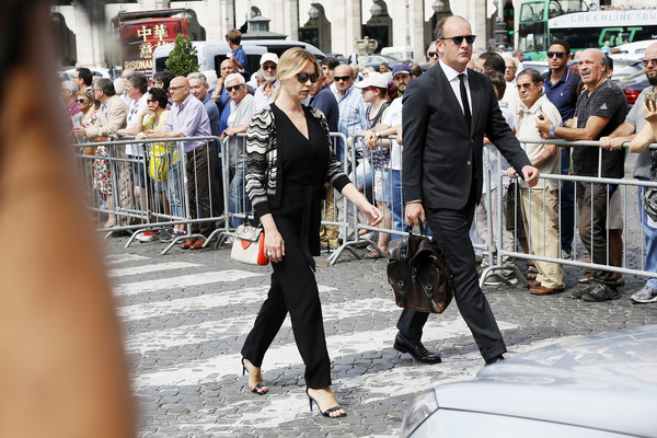 Carlo Vanzina Funeral In Rome [people,street fashion,fashion,snapshot,pedestrian,street,event,suit,photography,tourism,anna falchi,carlo vanzina,rome,carlo vanzina funeral,santa maria degli angeli,italy,funeral]