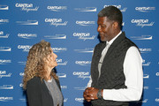 Edie Lutnick and Larry Johnson attend the Annual Charity Day hosted by Cantor Fitzgerald, BGC and GFI at Cantor Fitzgerald on September 11, 2018 in New York City.