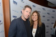 Actor Ed Burns and Co-Founder of the Cantor Fitzgerald Relief Fund Edie Lutnick attend the annual Charity Day hosted by Cantor Fitzgerald and BGC at Cantor Fitzgerald on September 11, 2015 in New York City.