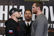 David Price and Sergey Kuzmin face off as promoter Eddie Hearn looks on during the Anthony Joshua And Alexander Povetkin Press Conference on September 20, 2018 in London, England.