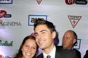 "Actor Zac Efron (R) with fan at the ""At Any Price"" premiere post party during the 2012 Toronto International Film Festival on September 9, 2012 in Toronto, Canada."