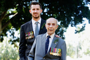 Mike Johnson, 23, poses with veteran Grath Turner, 90, during the Anzac Day Parade on April 25, 2015 in Sydney, Australia. Mike Turner was marching for his Grandfather who passed away 10 years ago and served in the 2-28th Battalion, 9th Division alongside Grath Turner. Australians are celebrating the centenary of the Australian and New Zealand Army Corp (ANZAC) landing on the shores of Gallipoli on April 25, 1915, during World War 1. Anzac day is a national holiday in Australia, marked by a dawn service held during the time of the original Gallipoli landing and commemorated with ceremonies and parades throughout the day.