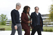 (L-R) Apple Inc. CEO Tim Cook, Oprah Winfrey and filmmaker Steven Spielberg pose for photos during an Apple product launch event at the Steve Jobs Theater at Apple Park on March 25, 2019 in Cupertino, California. Apple announced the launch of it's new video streaming service, unveiled a premium subscription tier to its News app, and announced  it would release its own credit card, called Apple Card.