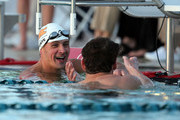 Ryan Lochte (L) jokes with Michael Phelps after the 100m Butterfly Finals during day two of the Arena Pro Swim Series at the Skyline Acquatic Center on April 16, 2015 in Mesa, Arizona.