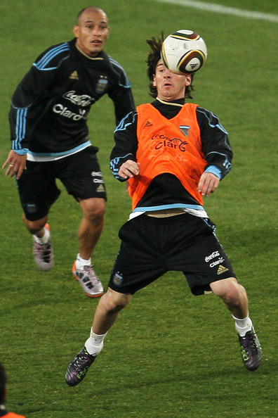 Lionel Messi of Argentina's National Team Controls the ball under pressure from Clemente Rodriguez during a team training session on June 6, 2010 in Pretoria, South Africa.