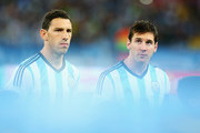 Maxi Rodriguez (L) and Lionel Messi of Argentina look on during the National Anthems prior to the 2014 FIFA World Cup Brazil Group F match between Argentina and Bosnia-Herzegovina at Maracana on June 15, 2014 in Rio de Janeiro, Brazil.