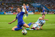 Senijad Ibricic of Bosnia and Herzegovina and Maxi Rodriguez of Argentina battle for the ball during the 2014 FIFA World Cup Brazil Group F match between Argentina and Bosnia-Herzegovina at Maracana on June 15, 2014 in Rio de Janeiro, Brazil.