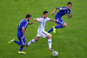 Maxi Rodriguez of Argentina controls the ball against Sead Kolasinac (L) and Muhamed Besic of Bosnia and Herzegovina during the 2014 FIFA World Cup Brazil Group F match between Argentina and Bosnia-Herzegovina at Maracana on June 15, 2014 in Rio de Janeiro, Brazil.