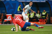 Angel Di Maria of Argentina kicks the ball against Guillermo Maripan of Chile during the Copa America Brazil 2019 Third Place match between Argentina and Chile at Arena Corinthians on July 06, 2019 in Sao Paulo, Brazil.