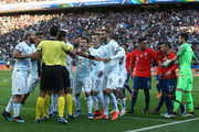 Players of Argentina and Chile argue with Referee Mario Diaz de Vivar after showing Gary Medel of Chile and Lionel Messi of Argentina (not in frame) the red card during the Copa America Brazil 2019 Third Place match between Argentina and Chile at Arena Corinthians on July 06, 2019 in Sao Paulo, Brazil.
