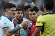 Lionel Messi of Argentina and Gary Medel of Chile argue with Referee Mario Diaz de Vivar after being shown the red card during the Copa America Brazil 2019 Third Place match between Argentina and Chile at Arena Corinthians on July 06, 2019 in Sao Paulo, Brazil.