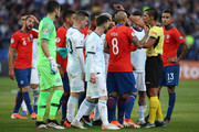 Players of Chile and Argentina argue with Referee Mario Diaz de Vivar after Gary Medel of Chile (not in frame) and Lionel Messi of Argentina were shown the red card during the Copa America Brazil 2019 Third Place match between Argentina and Chile at Arena Corinthians on July 06, 2019 in Sao Paulo, Brazil.