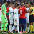 Lionel Messi Photos - Players of Chile and Argentina argue with Referee Mario Diaz de Vivar after Gary Medel of Chile (not in frame) and Lionel Messi of Argentina were shown the red card during the Copa America Brazil 2019 Third Place match between Argentina and Chile at Arena Corinthians on July 06, 2019 in Sao Paulo, Brazil. - Lionel Messi Photos - 11 of 14411