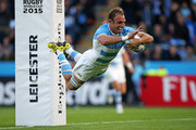 PJ van Lill of Argentina dives over to score a try during the 2015 Rugby World Cup Pool C match between Argentina and Namibia at Leicester City Stadium on October 11, 2015 in Leicester, United Kingdom.