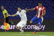 Angel Di Maria of Argentina fights for the ball with Júnior Alonso of Paraguay during a match between Argentina and Paraguay as part of South American Qualifiers for Qatar 2022 at Estadio Alberto J. Armando on November 12, 2020 in Buenos Aires, Argentina.