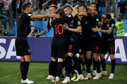 Ante Rebic of Croatia celebrates with teammates after scoring his team's first goal during the 2018 FIFA World Cup Russia group D match between Argentina and Croatia at Nizhny Novgorod Stadium on June 21, 2018 in Nizhny Novgorod, Russia.