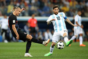 Domagoj Vida of Croatia passes the ball past Lionel Messi of Argentina during the 2018 FIFA World Cup Russia group D match between Argentina and Croatia at Nizhny Novgorod Stadium on June 21, 2018 in Nizhny Novgorod, Russia.