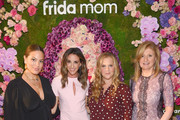Ashley Graham, Chelsea Hirschhorn, Amy Schumer and Arianna Huffington pose for a photo together as Arianna Huffington and Chelsea Hirschhorn host Frida Mom Launch Dinner With Amy Schumer on July 30, 2019 in New York City.