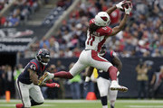Larry Fitzgerald #11 of the Arizona Cardinals catches a pass in the second quarter defended by Jelani Jenkins #44 of the Houston Texans at NRG Stadium on November 19, 2017 in Houston, Texas.