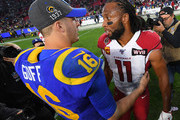 Quarterback Jared Goff #16 of the Los Angeles Rams is greeted by wide receiver Larry Fitzgerald #11 of the Arizona Cardinals after the game at the Los Angeles Memorial Coliseum on December 29, 2019 in Los Angeles, California.