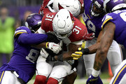 David Johnson #31 of the Arizona Cardinals is tackled with the ball in the third quarter of the game against the Minnesota Vikings at U.S. Bank Stadium on October 14, 2018 in Minneapolis, Minnesota.