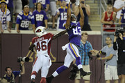 Rodney Smith #83 of the Minnesota Vikings makes a catch of the ball for a touchdown against Jimmy Legree #46 of the Arizona Cardinals during the fourth quarter of the preseason game on August 16, 2014 at TCF Bank Stadium in Minneapolis, Minnesota. The Vikings defeated the Cardinals 30-28.