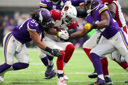David Johnson #31 of the Arizona Cardinals is tackled with the ball by Minnesota Vikings defenders in the third quarter of the game at U.S. Bank Stadium on October 14, 2018 in Minneapolis, Minnesota.