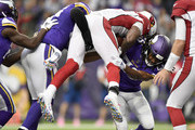 Anthony Barr #55 and Trae Waynes #26 of the Minnesota Vikings combine to tackle David Johnson #31 of the Arizona Cardinals in the third quarter of the game at U.S. Bank Stadium on October 14, 2018 in Minneapolis, Minnesota.