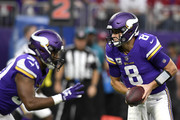 Kirk Cousins #8 of the Minnesota Vikings drops back with the ball in the fourth quarter of the game against the Arizona Cardinals at U.S. Bank Stadium on October 14, 2018 in Minneapolis, Minnesota.