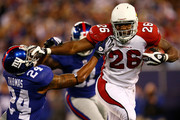 Beanie Wells #26 of the Arizona Cardinals fends off Terrell Thomas #24 of the New York Giants on October 25, 2009 at Giants Stadium in East Rutherford, New Jersey.