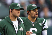 Tim Tebow and Mark Sanchez Photos Photo