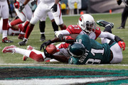 Michael Adams #27 of the Arizona Cardinals tackles Jason Avant #81 of the Philadelphia Eagles short of the goal line during the first half at Lincoln Financial Field on November 13, 2011 in Philadelphia, Pennsylvania.