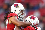 Karlos Dansby #56 of the Arizona Cardinals celebrates with Larry Fitzgerald #11 after an interception of C.J. Beathard #3 of the San Francisco 49ers during their NFL game at Levi's Stadium on November 5, 2017 in Santa Clara, California.
