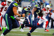 Running back Mike Davis #39 of the Seattle Seahawks rushes against the Arizona Cardinals in the third quarter at CenturyLink Field on December 31, 2017 in Seattle, Washington.