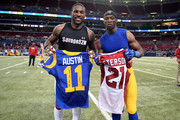 Patrick Peterson #21 of the Arizona Cardinals and Tavon Austin #11 of the St. Louis Rams exchange jerseys after the completion of a game at the Edward Jones Dome on December 6, 2015 in St. Louis, Missouri.